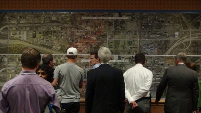 Residents mull proposed Crosstown Boulevard plans in last week's public meeting. (Ben Felder)