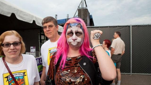 A festival attendee dressed as her favorite feline internet feline, Grumpy Cat