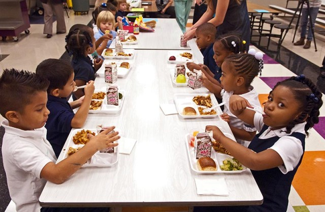 Students at Spencer Elementary eat lunch, which will be free for every student. (Mark Hancock)