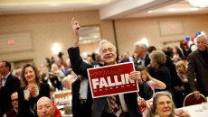 Raymond York cheers during a Republican Party election night watch party at Tower Hotel in Oklahoma City, Tuesday, Nov. 4, 2014.  (Garett Fisbeck)