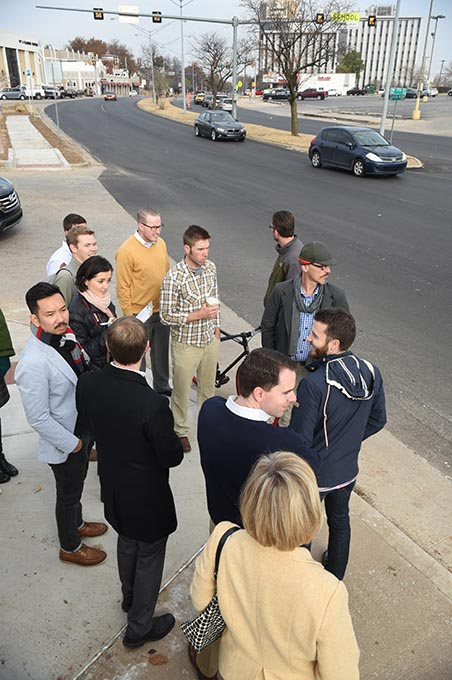 A group of urban planners, city officials and residents talk near the intersection of 17th Street and Classen Boulevard. (Mark Hancock)