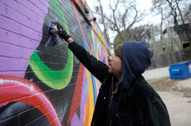 Artist Yatika Fields painted the mural on the side of Abraham's Bail Bonds. He has been a professional artist for about five years and was selected from 10 artists for the mural piece at 1219 N. Classen Blvd. (Garett Fisbeck)