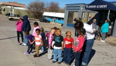 Angela Billings brings a class from Playground Academy daycare out to 23rd Street to watch a march on Martin Luther King Jr. Day. (Ben Felder)