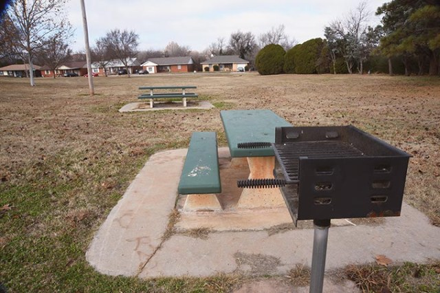 Eight restrictions accompany a couple of picnic benches and a small grill, but not much else encourages gatherings at McNabb Park in OKC. (Mark Hancock)