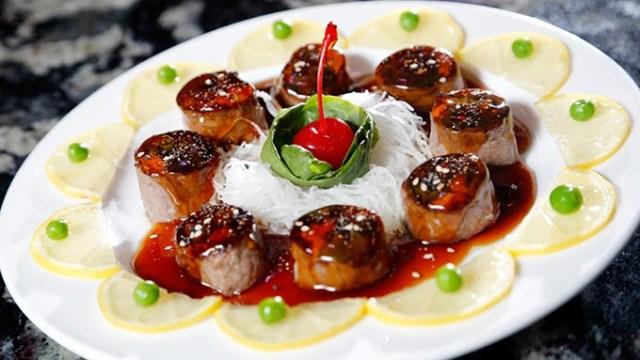 Beef Negimaki at Inaki Sushi & Bar in Oklahoma City, Wednesday, May 13, 2015.  (Garett Fisbeck)