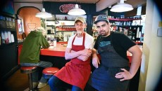 The Red Cup's founder and owner, Kurt Orth, left, with Patrick Clark (aka Chef Beave), on the stools in front of the bar at The Red Cup.  mh