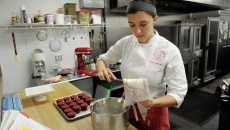 Ashleigh Barnett makes red velvet cupcakes at Crimson & Whipped Cream in Norman, Tuesday, July 21, 2015.  (Garett Fisbeck)