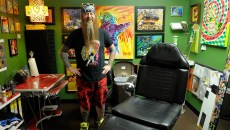 Rawb Carter poses for a photo at his booth at Mind Bender Tattoo Shop in Oklahoma City, Wednesday, July 22, 2015.  (Garett Fisbeck)