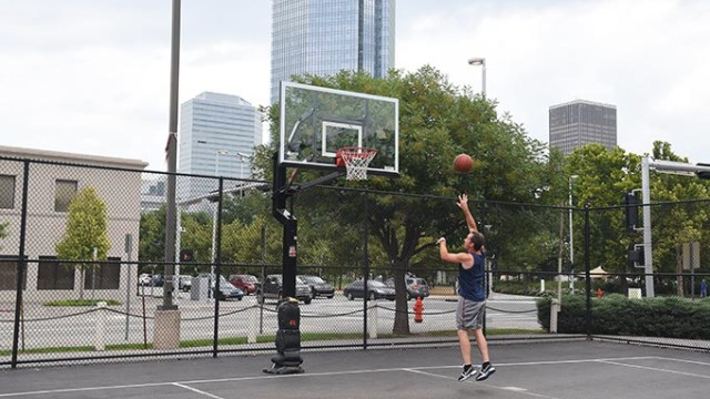 Jeff Danning who works at Devon Energy, spends a recent lunch hour on the Downtown Basketball Court.  mh