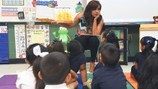 Herronville Elementary School Pre-K teacher, Maria Rios teaches from a book in front of her class.  mh