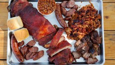 Ribs, Burnt ends, Smoked hot link and sausage, Pulled pork, and Apple pie baked beans at Butcher BBQ in Wellston, Friday, Aug. 7, 2015.  (Garett Fisbeck)