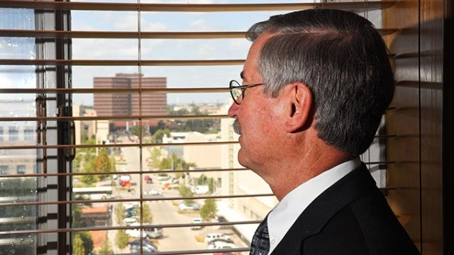 Judge Ray Elliott looks out of his office window in the Oklahoma County Courthouse towards the Oklahoma Coutny Jail, 9-16-15.  (Mark Hancock)