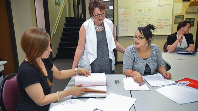 Terri Woodland, executive director, works with, from left, Kamber Caulkins, and Ashley Hall, phase 1 participants in the ReMerge program, at their new facilities inside the building which houses Northcare, at 1140 N. Hudson Avenue.  mh