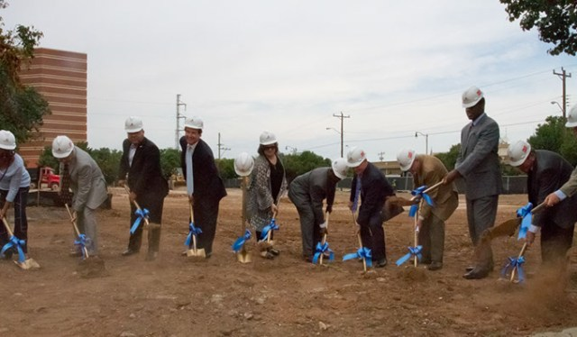 Officals with shovels breaking ground on the beginning construction of the new municipal courts building in Oklahoma City, Monday, August 3, 2015. (Keaton Draper)