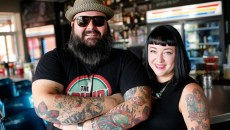 Ian and Hailey McDermid, owners, pose for a photo at the Pump Bar in Oklahoma City, Tuesday, Sept. 8, 2015.  (Garett Fisbeck)