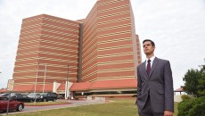 A graduate student in Harvard University's public policy program, Adam Luck, stands next to the Oklahoma County Jail, 10-8-15.  (Mark Hancock)