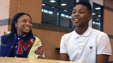 From left, Breonna Hall enjoys an answer givien by fellow student, Trevion Ellis, during the Gazette's interview at Millwood High School, 10-5-15.  (Mark Hancock)