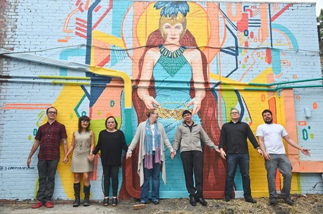 "Plaza Gallery Group has come together to find ways to provide a ""fuller art experience in the Plaza."" From left Dylan and Amanda Bradway, Crystal Murphy, Stacey D. Miller, Tony Morton, Benny Jacobs and JT Coburn in front of the Plaza Disrict's Plaza Walls  mural by Erin Cooper.  (Mark Hancock)"