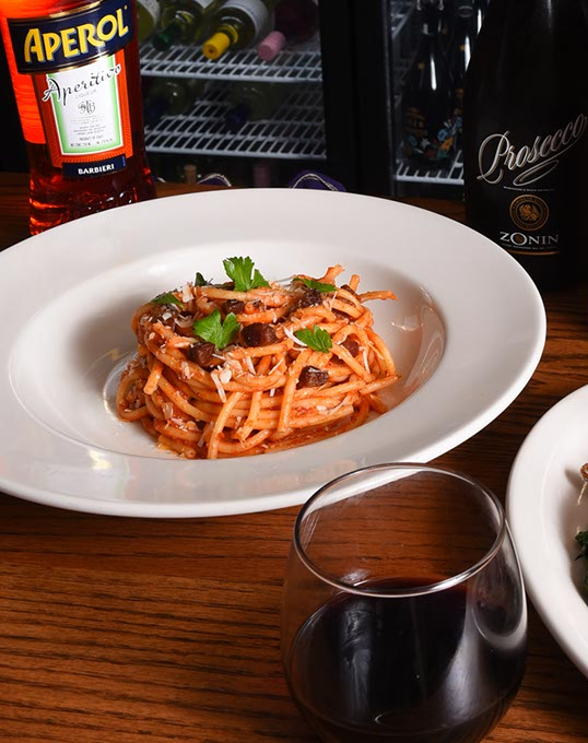 <em>Bucatini all'Amatriciana</em> pasta, with Pinnacoli red wine at Patrono. (Mark Hancock)