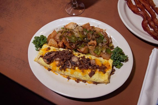 Sausage-and-mushroom omelet with homefries at Cattlemen's Steakhouse (Mark Hancock / File)