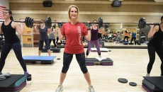Michele Taylor, executive director for the Downtown, Mains Street, and MidTown YMCAs, lifts weights in a class at the Downtown YMCA, 1-7-16.  (Mark Hancock)