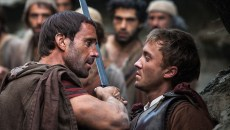 Clavius (Joseph Fiennes, left) warns Lucius (Tom Felton) to let them all pass after he discovers him leading the apostles away from Roman soldiers in Risen. (CTMG / Rosie Collins / Provided)