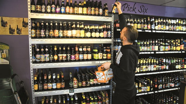The Wine Gallery features Pick Six beers from a large selection, with owner Adam Duffy demonstrating on south Western Avenue in OKC.  mh