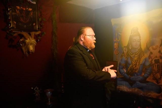 Adam Daniels talks about an upcoming black Mass at the Church of Ahriman in Oklahoma City. (Garett Fisbeck)
