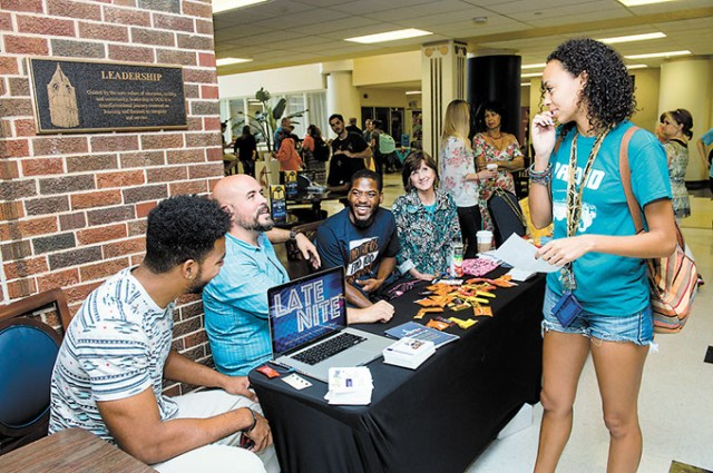 Representatives from Edmond's Spring Creek Assembly of God speak to a student during UCO's 2015 Interfaith Fair. (UCO Photo Services / KT King / provided)