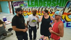 Left to right, Sean Vali, Warren Pete, school principal, Romy Owens, and Jason Pawley discuss murals on the cafeteria walls at F.D. Moon Elementary School, 1901 N.E. 13th Street in Oklahoma City, during the mural painting project, 7-14-16.  (Mark Hancock)