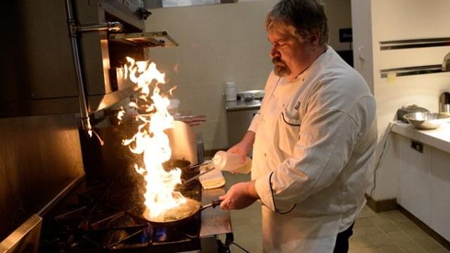 Chef Frank Keith pan-sears a salmon at E.S. Founders in Oklahoma City, Friday, July 22, 2016.  (Garett Fisbeck)