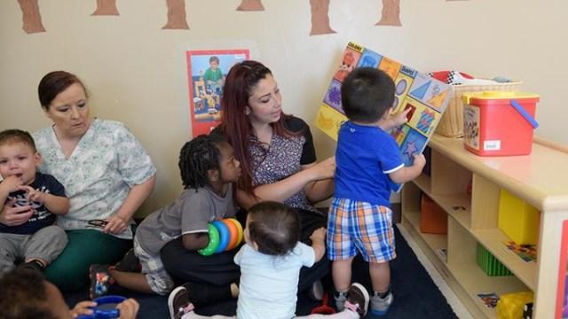 Elysia Sianiz reads to children at KidZone, Tuesday, Sept. 13, 2016.  (Garett Fisbeck)