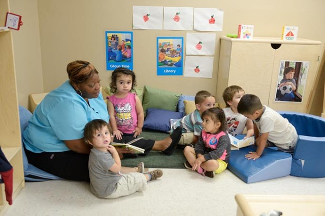 Danyale Murray reads to children at Kidzone Learning Center, an Oklahoma City childcare facility benefiting from a partnership with Sunbeam Family Services. (Garrett Fisbeck)