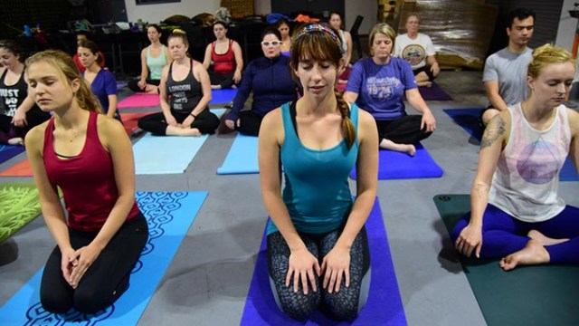 Participants begin a class of Beer Yoga, at Coop Ale Works in southwest Oklahoma City, 10-15-2016.  (Mark Hancock)