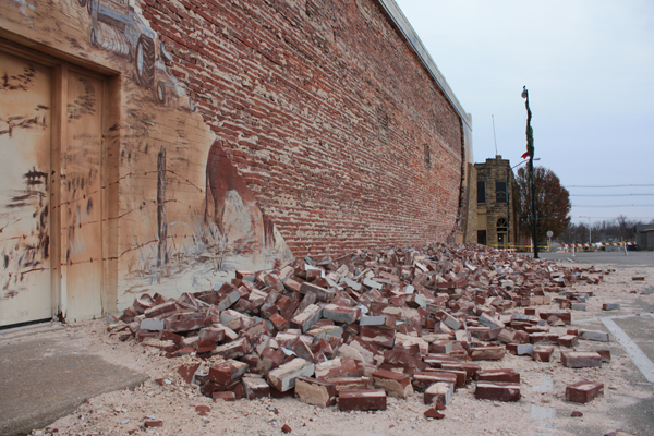 A wall of mural bricks fell from the Lions Club building in downtown Cushing following a November 5.0 magnitude earthquake. (Laura Eastes)