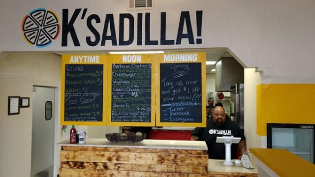 OK'sadilla! owner Charles Griffis works the register. | Photo Greg Elwell