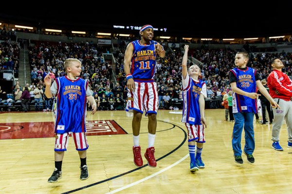 Globetrotter Hammer Harrison leads youth on the court during a game. (The Original Harlem Globetrotters / provided)