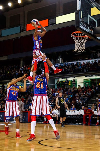 Rocket Pennington dunks a ball during a Globetrotters game. (Alden Skele / The Original Harlem Globetrotters / provided)