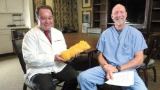 Dr. J. Arden Blough and Chiropractor Todd Farris pose for a photo at Broadway Clinic in Oklahoma City, Monday, Jan. 16, 2016.  Dr. Blough holds a prop representing five pounds of body fat. (Garett Fisbeck)