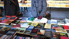 London, England - January 24, 2015: People browsing the books for sale at the Southbank Centre Book Market in London, England. Located beneath the Waterloo Bridge the market is open all year round.