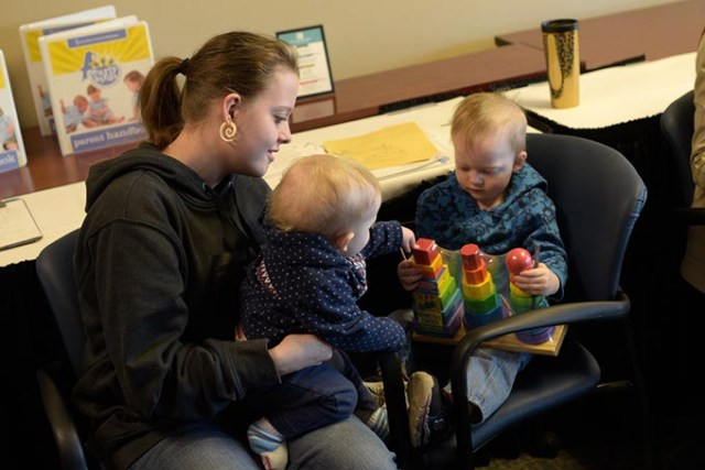 Susan Dougherty plays with her children Logan Hinkle, 2, and Alex Hinkle, 1, during an Early Bird class at Metro Technology Center. (Garett Fisbeck)