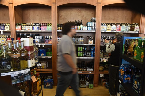 An employee walks past the beer selection at Pancho's Liquortown in Oklahoma City. Senate Bill 211, if passed, would allow counties to decide whether liquor stores could be open on Sundays. (Gazette / file)