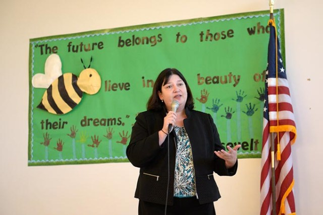 Oklahoma City Public Schools Superintendent Aurora Lora addresses parents and community members about the district's plan to consolidate schools during a public meeting last week at Andrew Johnson Elementary School in The Village. (Garett Fisbeck)