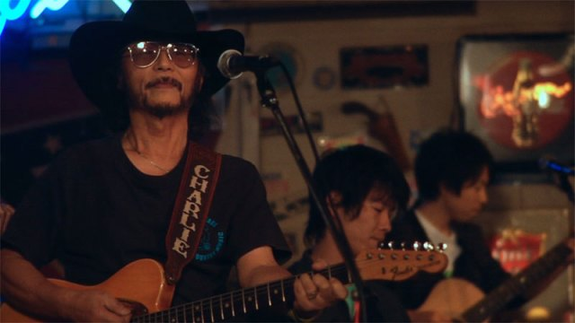 Charlie Nagatani performs at his Japanese honky-tonk Good Luck Charlie's in <em>Far Western</em>. (provided)