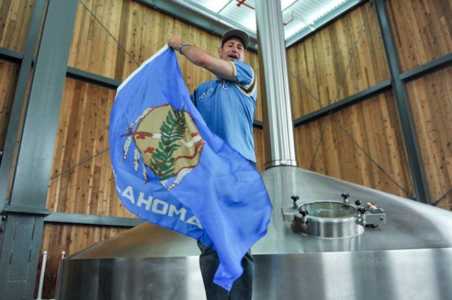 Dogfish Head Craft Brewery founder and CEO Sam Calagione waves the Oklahoma flag to celebrate the brewery shipping beer to the Sooner State. (Dogfish Head Craft Brewery / provided)