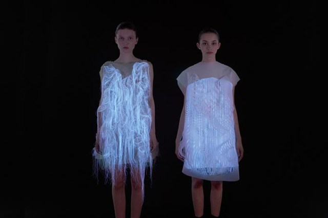 Two models display a pair of photoluminescent dresses by Chinese designer Ying Gao. Gao's work is displayed in <em>Coded_Couture</em>, which opens Thursday at Oklahoma Contemporary. (Dominique Lafond / Ying Gao / provided)