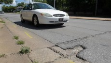 Damaged roads on North Classen Boulevard, Thursday, July 6, 2017.  (Garett Fisbeck)