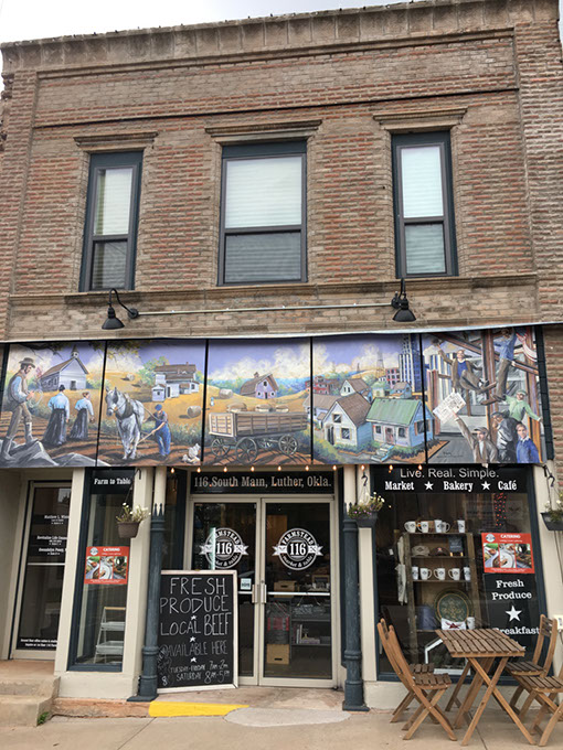 The exterior mural at 116 Farmstead in  downtown Luther depicts the town's history. | Photo Jacob Threadgill