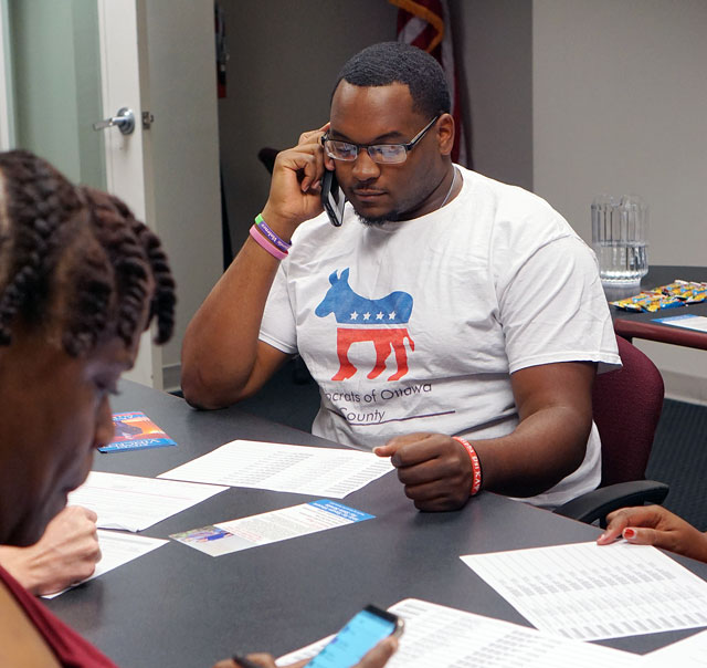 Joshua Harris-Till, who serves as Young Democrats of Oklahoma president, makes calls to voters in Senate District 45 in support of the Democratic candidate. (Megan Nance)