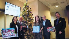 Community members from left Amber Jones, Joe Dorman, Miranda Hines, Scott Bell and Mitchell Rozin behind Oklahoma Institute for Child Advocacy and OK Foster Wishes' gift drive for foster children and teenagers encourage the community to donate. | Photo Laura Eastes
